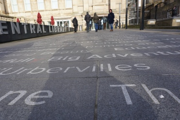 the library forecourt, with book titles