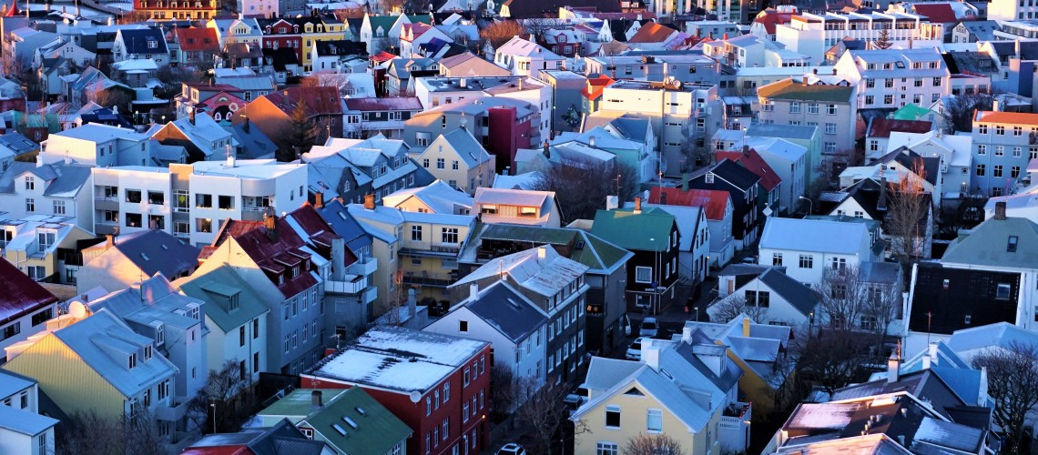 pastel rooftops dusted with snow